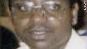 This grainy image issued by Interpol shows a man believed to be Emmanuel Uwayezu.