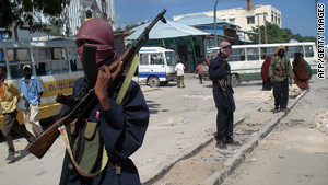 Heavily-armed militants patrol the streets of Somalia's crumbling capital, Mogadishu.