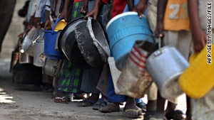 Internally diisplaced Somali boys line up for food in Mogadishu last month.