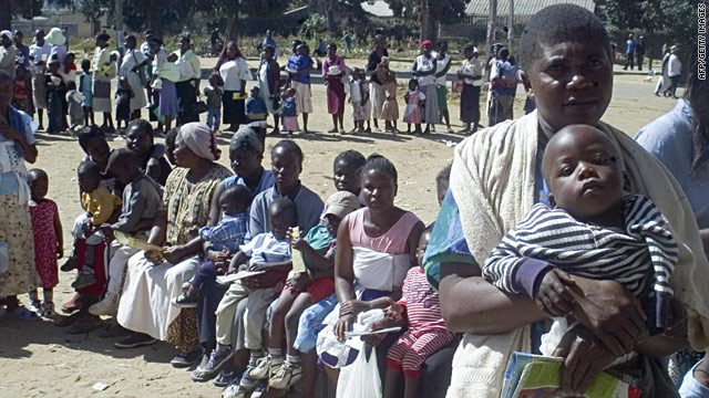 Women queue in June 2006 to have their children immunized against measles in Harare's poor suburb of Mabvuku.