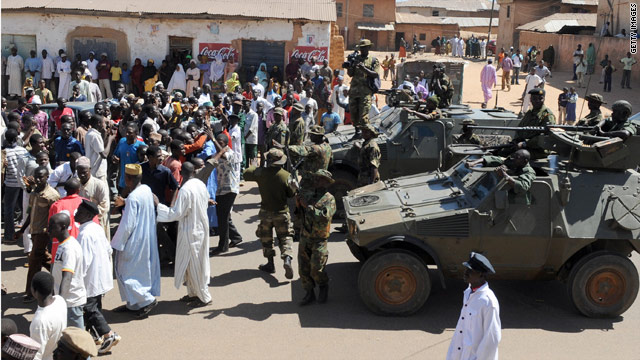 Soldiers stand guard after December 2008 post-election riots in central Nigeria leave hundreds dead.