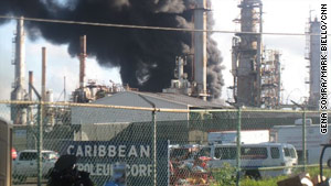 Smoke billows from the fuel depot fire near San Juan, Puerto Rico, on Sunday morning.