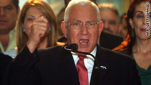 Roberto Micheletti gives a speech to announce the formation of a unity government.