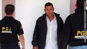 Mexican police arrest Santiago Iniguez Olivares.