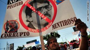 An anti-Ortega protester marches Saturday in Managua, Nicaragua.