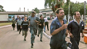 A combat alarm sends Cuban workers to their positions in 2004, the last time such a large military exercise took place.