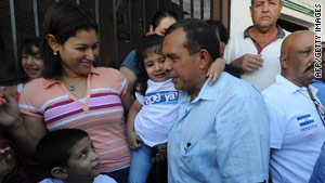 Porfirio Lobo Sosa greets supporters during elections Sunday in Juticalpa, northeast of Tegucigalpa, in Honduras.