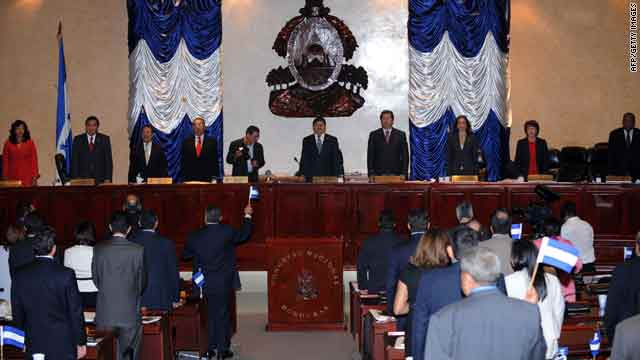 Members of the Honduran congress sing the national anthem after rejecting the reinstatement of ousted President Jose Manuel Zelaya on Wednesday.