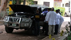 Police inspect the vehicle driven by Gonzalez, who was shot dead on Tuesday.