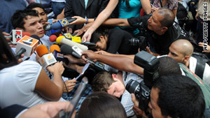 Protest leader Julio Rivas talks with journalists after students called off an 18-day hunger strike in Venezuela.