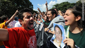 Students demonstrate against the death of Jesus Ramirez along one of the main avenues in Caracas, Venezuela, on Wednesday.