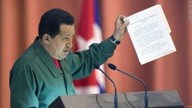 Venezuelan President Hugo Chavez shows former Cuban President Fidel Castro's letter during the closing ceremony of the ALBA Summit in Havana on Monday.