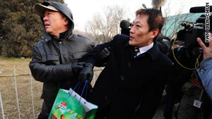Shang Baojun, lawyer for Liu Xiaobao, is handled by a plainclothes security worker outside a Beijing courthouse.