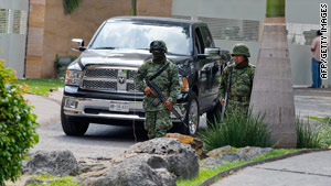 Mexican marines on December 17  guard the complex where Arturo Beltran Leyva was killed.