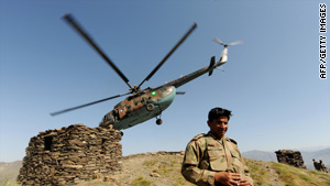 A Pakistani army officer walks down from a hill top after landing in a helicopter in Mingora on June 3, 2009.