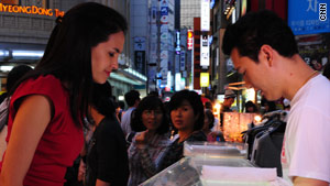 CNN's Kristie Lu Stout eyes some of the food on offer on Seoul's streets.