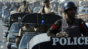 Police patrol a street in Karachi Oct. 26 as public and private schools were closed across Pakistan.