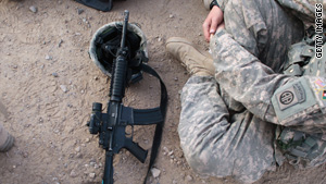 A U.S. Army soldier sits with his rifle on the ground during a meeting of Pashtun leaders Monday in Afghanistan.