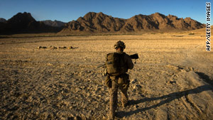 A U.S. Marine patrols in the Farah Province in southern Afghanistan October 9.