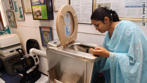 To meet its sanitation goal by 2012, India must build 112,000 toilets a day.
