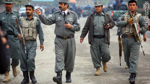 Afghan police rush to the site of a Taliban attack on a hotel  in Kabul on Wednesday.