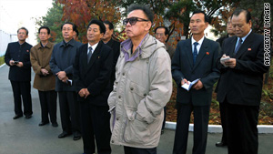 This undated photo released on October 25, 2009, shows Kim Jong Il, foreground, inspecting a university in Noth Korea.