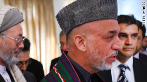 Hamid Karzai addresses a press conference at the Presidential Palace on November 3.