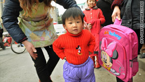 A young Chinese girl displays Disney products in Shanghai's town of Chuansha on March 7, 2008.