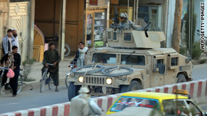 A U.S. military humvee patrols in Kandahar, Afghanistan, earlier this week.