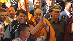Tibetan spiritual leader the Dalai Lama gestures on his arrival at Tawang monastery.