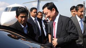 Former Thai Prime Minister Thaksin Shinawatra arrives at a military air base in Phnom Penh.