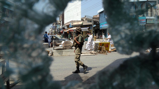 A Pakistani soldier patrols Mingora, the main town of Swat Valley, on August 1, 2009.