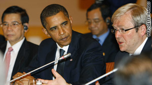 U.S. President Barack Obama, center, listens to Australian Prime Minister Kevin Rudd in Singapore.