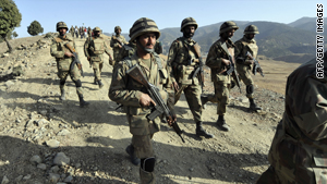 Pakistani troops patrol in Ladha, a town in the troubled tribal region of South Waziristan on Tuesday.