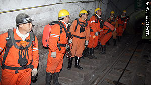 Chinese rescuers prepare to enter the mine where the accident occurred.