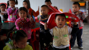 Children play in a temporary classroom in Sichuan Province, one year after the devastating earthquake.