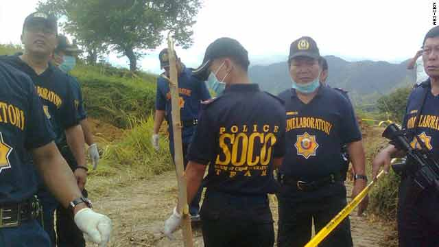 Police investigate where the bodies were found in Maguindanao, Philippines.