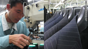 A man works in the Dayang Trands factory while Trands suit jackets hang on a rack.