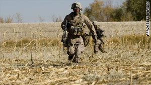 A U.S. Marine runs for cover after his unit comes under fire in Afghanistan's Helmand Province on Wednesday.