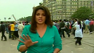 CNN's Sara Sidner shown reporting from Mumbai one year ago outside the Taj Hotel.