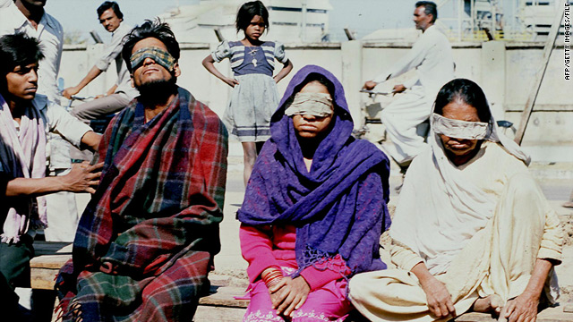 Victims blinded by methyl isocyanate gas are attended to outside the Union Carbide plant after the disaster of December 3, 1984.