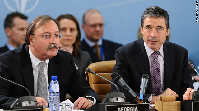 NATO Secretary General Anders Fogh Rasmussen (R) attends a NATO meeting in Brussels on Thursday, December 3