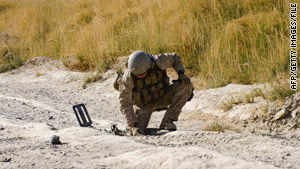 A U.S. Marine searches for roadside bombs last week in Afghanistan's Helmand province.