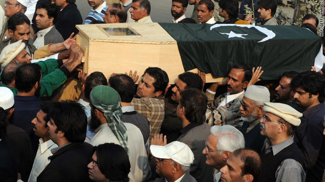 Pakistani men carry a coffin during a funeral ceremony in Lahore for a victim of the Rawalpindi Mosque attack.