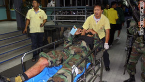 Hospital workers help a Thai soldier injured in the blast in Narathiwat province.