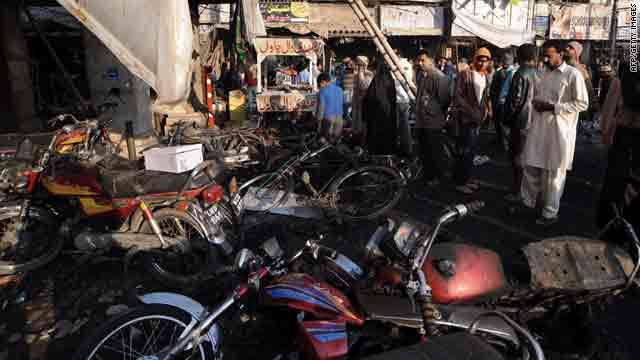 Residents in Lahore, Pakistan, gather on Tuesday in the aftermath of a bomb attack on a market.