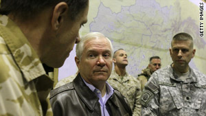 U.S. Defense Secretary Robert Gates is briefed by officials on a recent trip to Afghanistan.