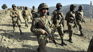 Pakistani troops patrol on a hill top post in South Waziristan along the Afghan border on November 17.