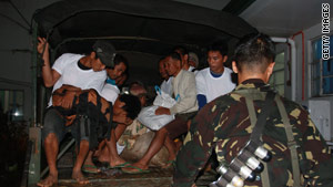 Filipino civilians arrive at a hospital after they were released by a group of tribal gunmen.