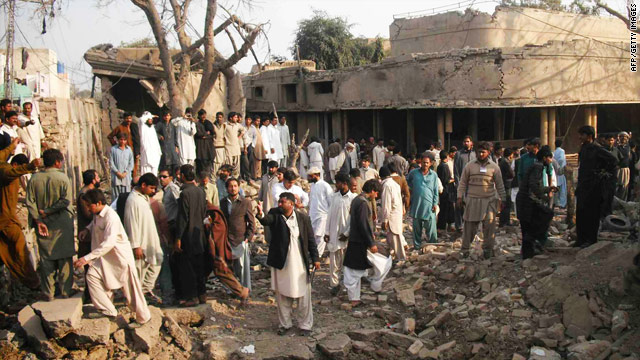 Rescuers and onlookers gather at the site of a car bomb blast in Dera Ghazi Khan, Pakistan, on Tuesday.